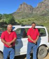 Ricardo Adams and Deon Lucas of Silvermine Protection Services with Silvermine Peak in the background
