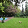 Woodlands Escape guest swimming pool area and garden