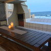 Outdoor entertainment-dining area and built-in braai-barbecue overlooking the ocean