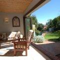 The breakfast patio opens onto the garden in summer