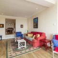 Large Unit 6 - lounge area with two extra single beds in the front