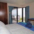 En-suite bedroom with ocean view