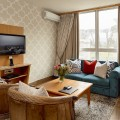 Flatscreen televisions in both the bedroom and lounge