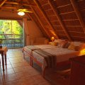 Our Leopard room is a romantic twin room under an exposed thatch roof and with a private balcony.