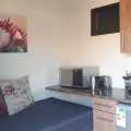 Blue Sea Unit 3. Separate open plan open plan TV lounge , Flat screen TV, seating is double purpose  - consist of  a heavy duty cloud nine luxury bed which can be used as TV Couch or as a bed for a third guest. Kitchenette with fridge, microwave, kettle,