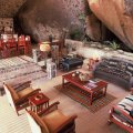 The Leopards Lair dining room incorporates a 60 ft boulder into the room