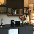 Kitchen with kettle, toaster, fridge, microwave and gas hob