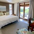 Duminy:  Bedroom 2 with en-suite bathroom also leads to the stoep with views. Wheel chair accessible.