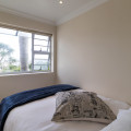 Large Unit 6 -second bedroom, small suitable for a young couple or kids, has an extra single in this room and one in he lounge area