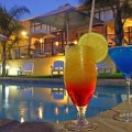 Sundowner cocktails by the pool
