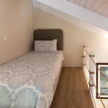 Single bed on loft platform
