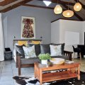 Fynbos Trail:  Sleeps 2+1 in one room with galley kitchen with gas stove..  Covered porch with seating and mountain views. Outdoor firepit and braai.