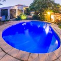 Outdoor swimming pool by Family room