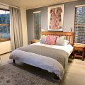 Duminy: Bedroom 1 with en-suire bathroom with tub & outdoor shower. Gorgeous mountain & lagoon views from the bedroom.