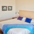 En-suite bedroom with kingsize bed