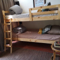 The kiddies room is ideal for teenagers. Opens out into the braai area.
