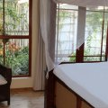 Four - Poster Bed with view to Koi-Pond