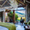 Fireplaces, soft netting and the view from Lagoon Lodge Suite