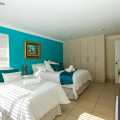 Turquois room queen and single beds
