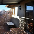 Safari Suite- Rose Quartz Outdoor Bathroom with shower and victorian bath.JPG