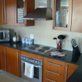 Moddern kitchen with fully equipped laundry