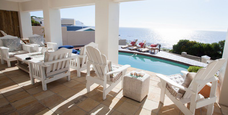 Pool deck with view of False Bay