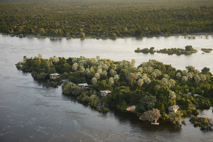 Victoria Falls River Lodge - Island Treehouse Suites in foreground, Luxury Tented Suites in background