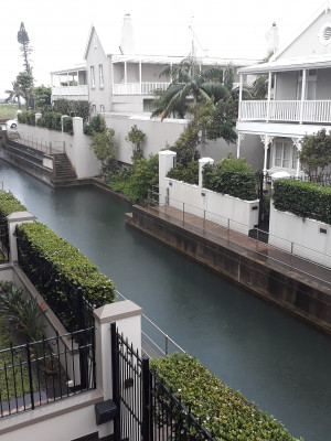 View of canal from upstairs balcony off main bedroom