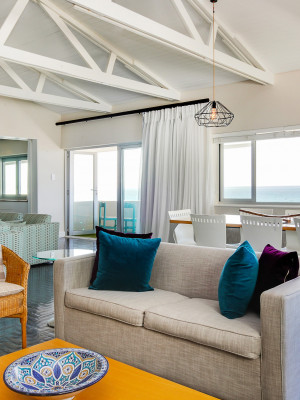 Living area with sea views and balcony in background